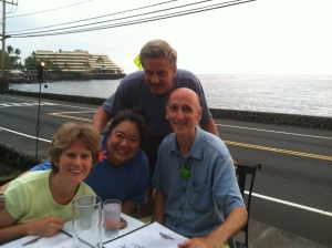 Here are the four of us!  After ordering, it started to rain, so we moved inside under cover.